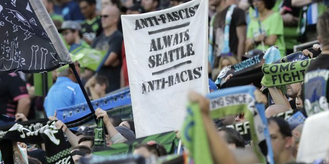 "​​​​​​​A sign that reads ""Anti-Facist Always Seattle Anti-Racist"" is displayed in the supporters section during an MLS soccer match between the Seattle Sounders and the Portland Timbers in Seattle, July 21, 2019. (Associated Press)"