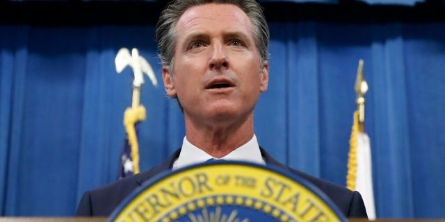 California Gov. Gavin Newsom during a news conference in Sacramento, Calif. Newsom signed a law Tuesday, July 30, requiring presidential candidates to release their tax returns to appear on the state
