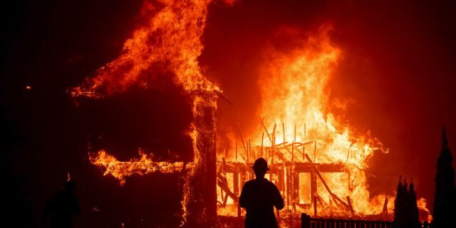 A home burns as the Camp Fire rages through Paradise, Calif,. on Nov. 8, 2018. (AP Photo/Noah Berger,File)