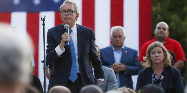 Ohio Gov. Mike DeWine, left, speaks alongside Dayton Mayor Nan Whaley, right, during a vigil at the scene of a mass shooting, Sunday, Aug. 4, 2019, in Dayton, Ohio. (Associated Press)