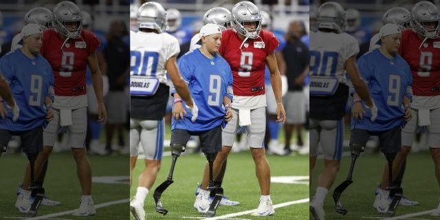 Calder Hodge, 14, of Magnolia, Texas, prepares to run a play with Detroit Lions quarterback Matthew Stafford during an open practice at Ford Field on Friday. Hodge was born without tibia bones but that hasn