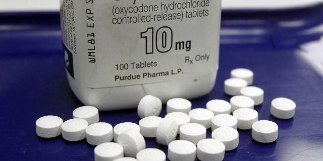 This Feb. 19, 2013 file photo shows OxyContin pills arranged for a photo at a pharmacy in Montpelier, Vt. State attorneys general and lawyers representing local governments said Tuesday, Aug. 27, 2019, they are in active negotiations with Purdue Pharma, maker of the prescription painkiller OxyContin, as they attempt to reach a landmark settlement over the nation