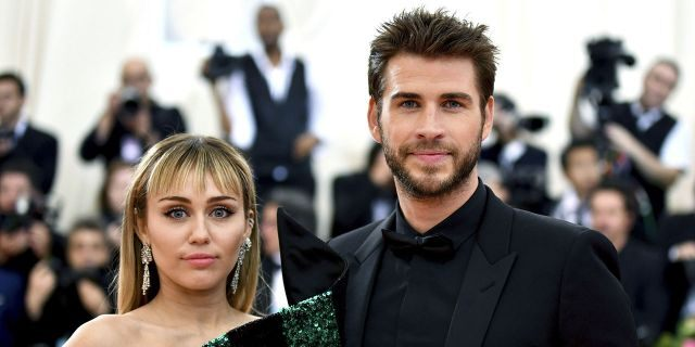 Miley Cyrus, left, and Liam Hemsworth attend the Metropolitan Museum of Art