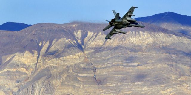 FILE: An F/A-18D Hornet from the VX-9 Vampire squadron at Naval Air Weapons Station China Lake, flies out of what is known as Star Wars Canyon toward the Panamint range in Death Valley National Park, Calif.