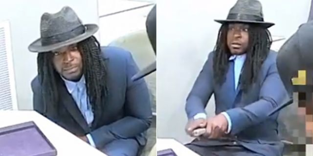 One of the suspects in a robbery at the Avianne & Co. jewelry store in New York City on Sunday is pictured staring into a camera before pulling out a handgun.