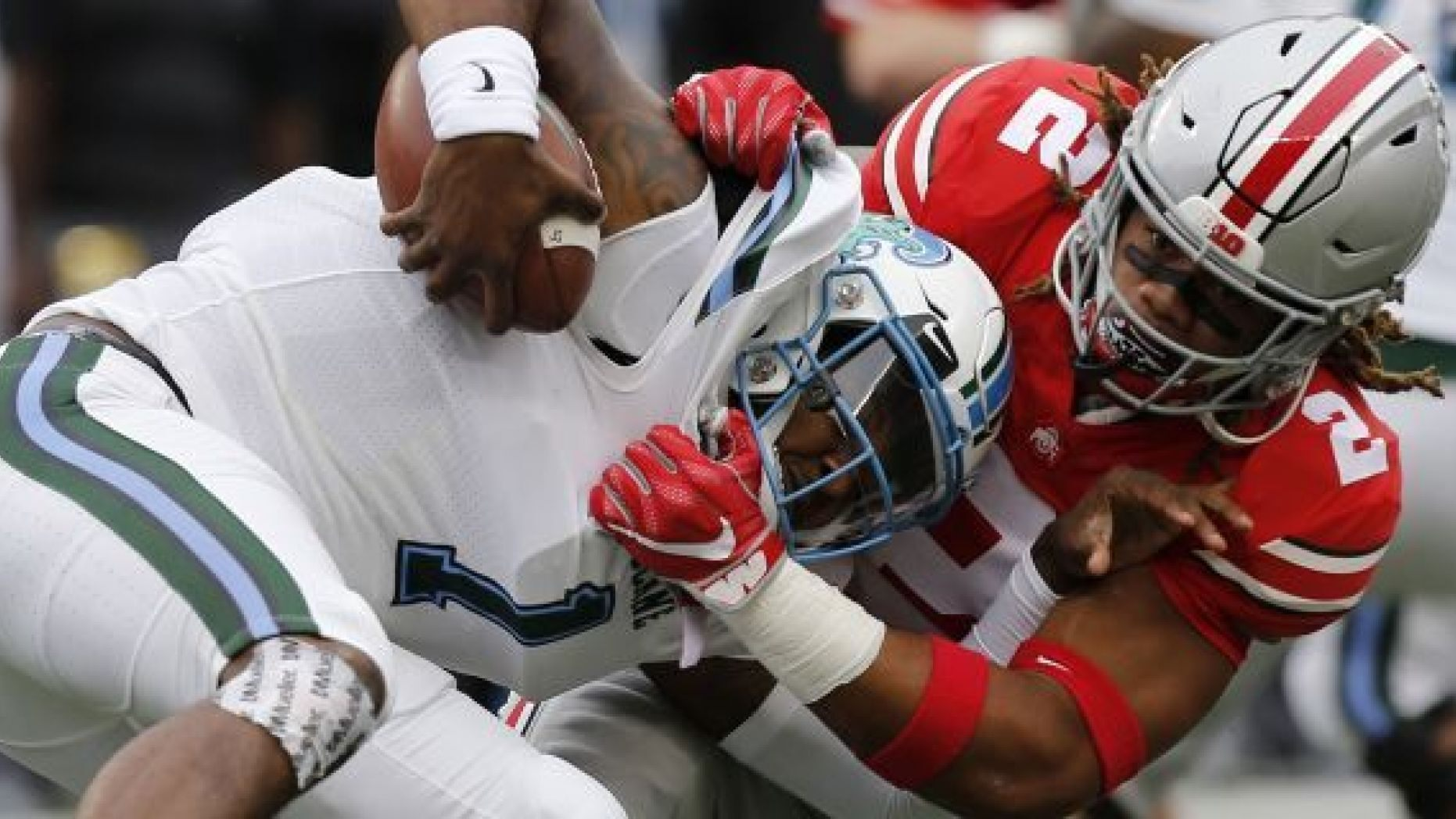 FILE - In this Sept. 22, 2018, file photo, Ohio State defensive end Chase Young, right, sacks Tulane quarterback Jonathan Banks during the first half of an NCAA college football game, in Columbus, Ohio. Chase Young is known to lead with his mouth. Being the loudest Buckeye on the field is part of the reason his teammates elected him a captain this season. (AP Photo/Jay LaPrete, File)