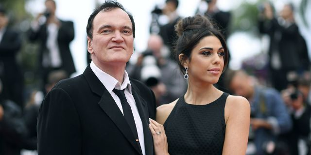 """FILE - In this May 18, 2019 file photo, film director Quentin Tarantino and his wife Daniela Pick pose for photographers upon arrival at the premiere of the film """"The Wild Goose Lake"""" at the 72nd international film festival, Cannes, southern France. Tarantino is about to become a father. His representative Katherine Rowe says the """"Once Upon a Time... In Hollywood"""" director and his wife, Israeli model and singer Pick, are expecting a baby. The couple met in 2009 and married last November. It's the first child for the 56-year-old Tarantino, who also directed """"Pulp Fiction"""" and """"Reservoir Dogs,"""" and the 35-year-old Pick. (Photo by Arthur Mola/Invision/AP, File)"""