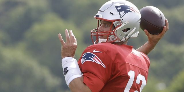 New England Patriots quarterback Tom Brady winds up to pass during an Aug. 1 NFL football training camp practice in Foxborough, Mass. (AP Photo/Steven Senne)