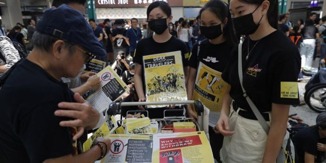 Protesters promote their cause at the airport In Hong Kong on Friday, Aug. 9, 2019. Pro-democracy protesters held a demonstration at Hong Kong