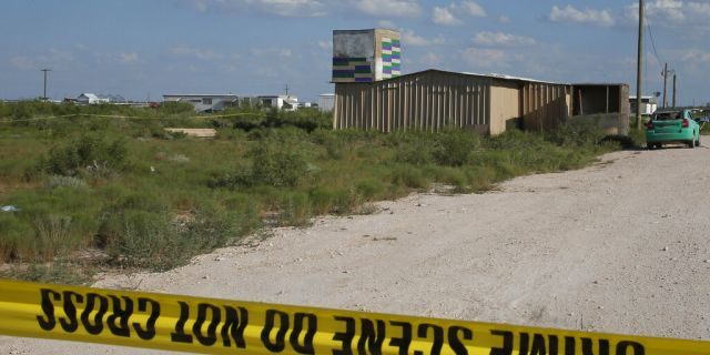 Crime scene tape surrounds the home of the alleged gunman in a West Texas rampage Saturday, on Monday, Sept. 2, 2019, near Odessa, Texas. (AP Photo/Sue Ogrocki)