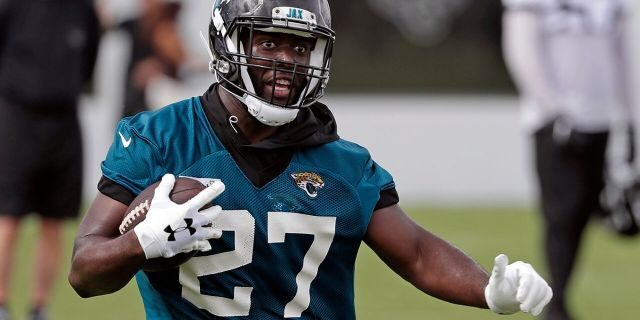 In this June 12, 2019, file photo, Jacksonville Jaguars running back Leonard Fournette runs with the ball during an NFL football practice in Jacksonville, Fla. Ultimately, Fournette's growth will be determined by how he performs on and off the field. (AP Photo/John Raoux, File)