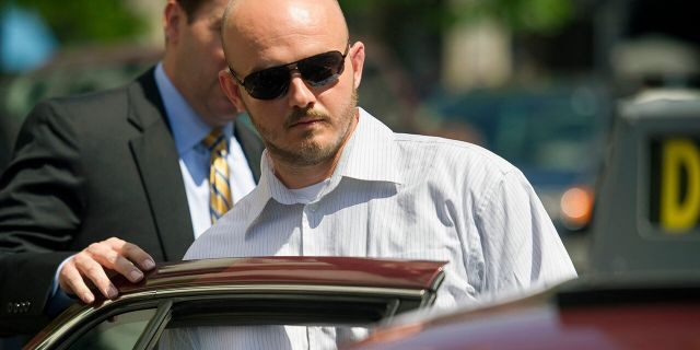 In this June 11, 2014, file photo, former Blackwater Worldwide guard Nicholas Slatten enters a taxi cab as he leaves federal court in Washington, after the start of his trial. (AP Photo/Cliff Owen, File)