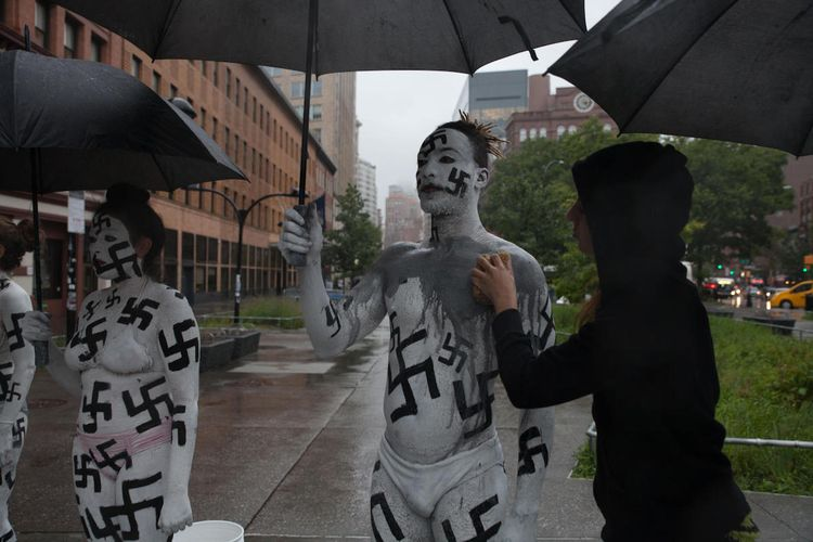 """Artists confront """"neo-fascist plague"""" in performance in New York"""