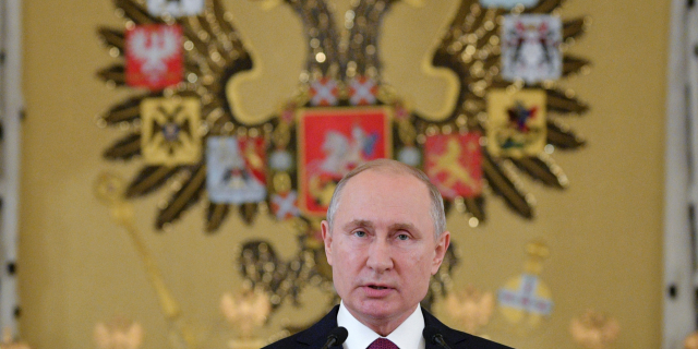 Russian President Vladimir Putin speaks during a reception for graduates of Russian military education institutions in the Kremlin in Moscow, Russia, on Thursday, June 27, 2019. (Alexei Druzhinin, Sputnik, Kremlin Pool Photo via AP)