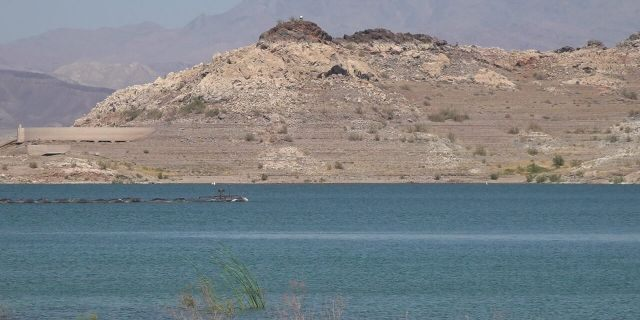 A lingering 20-year drought has caused water levels in Lake Mead to drop, triggering mandatory water cuts for Arizona and Nevada next year.