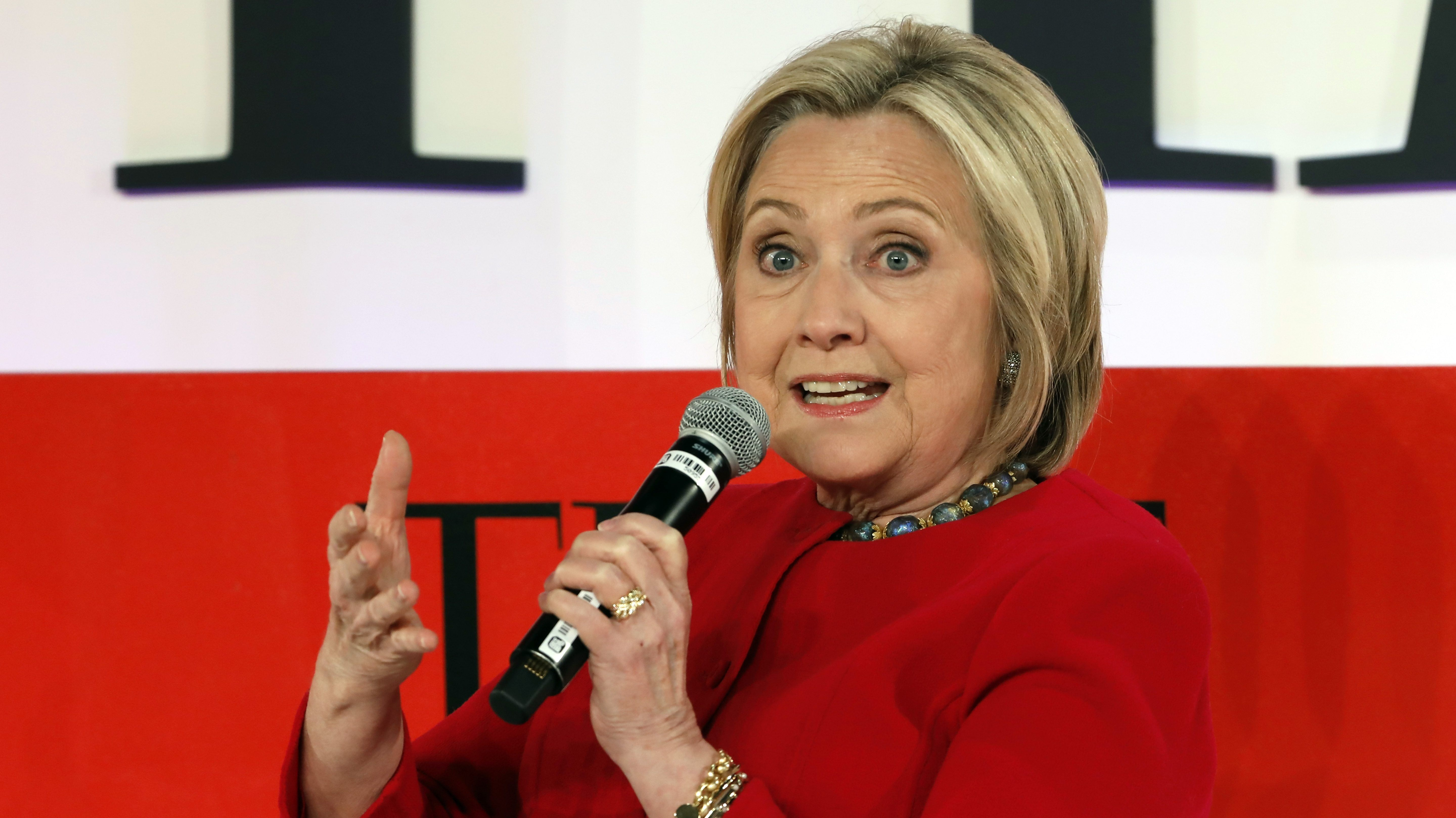Hillary Clinton gets brutally mocked for reading printouts of her own emails at art exhibit